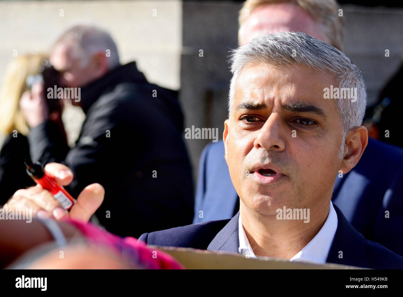 Sadiq Khan, Mayor of London, signing autographs at the Heroes Return celebration for the GB Olympic and Paralympic - Stock Image