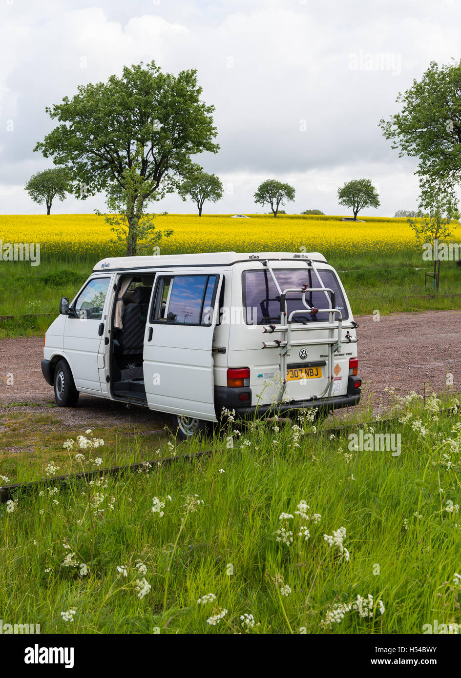VW Camper Van Wild Camping in Sweden Stock Photo