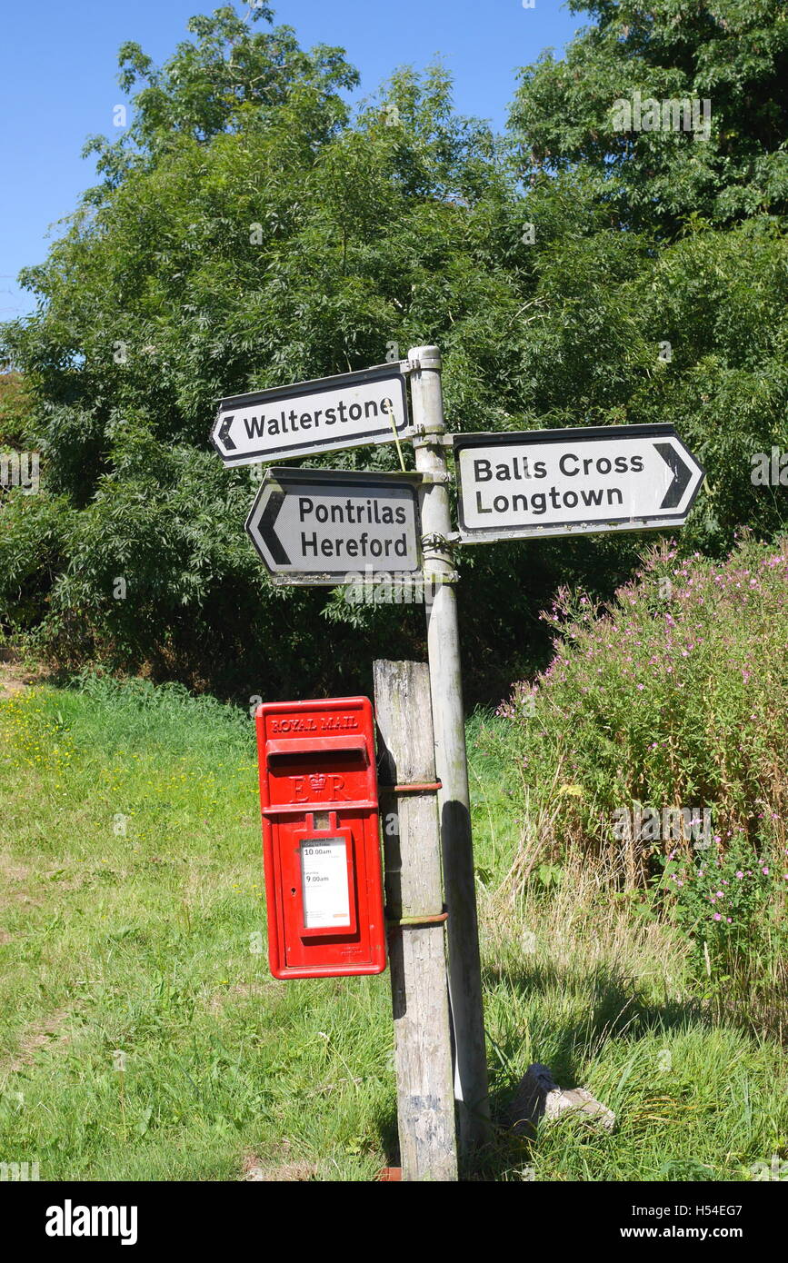 Road sign and Royal Mail post box, Rowlestone, Herefordshire, England Stock Photo