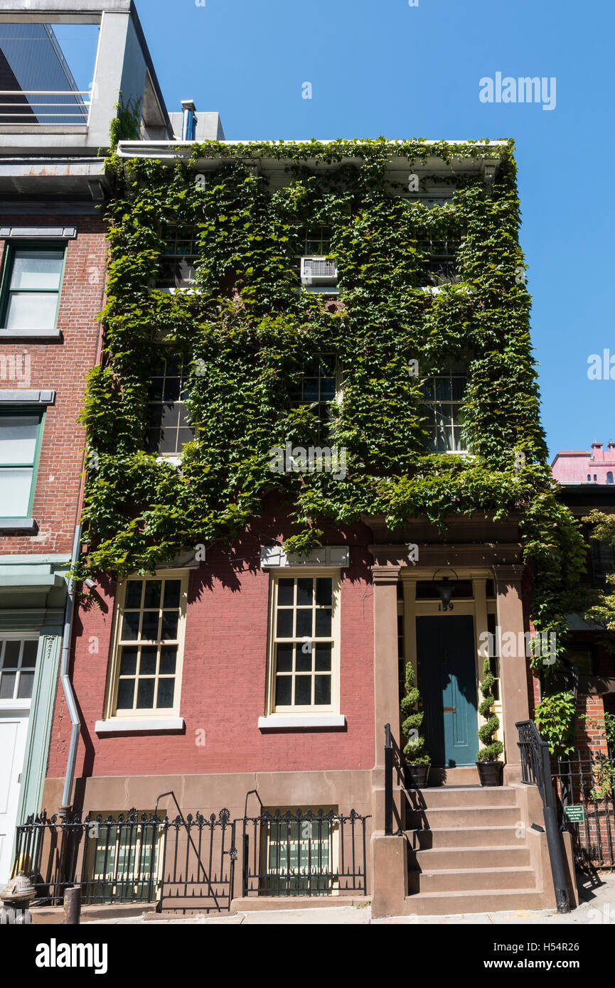 Landmarked exterior of a Greek Revival style townhouse on Charles Street, New York. - Stock Image