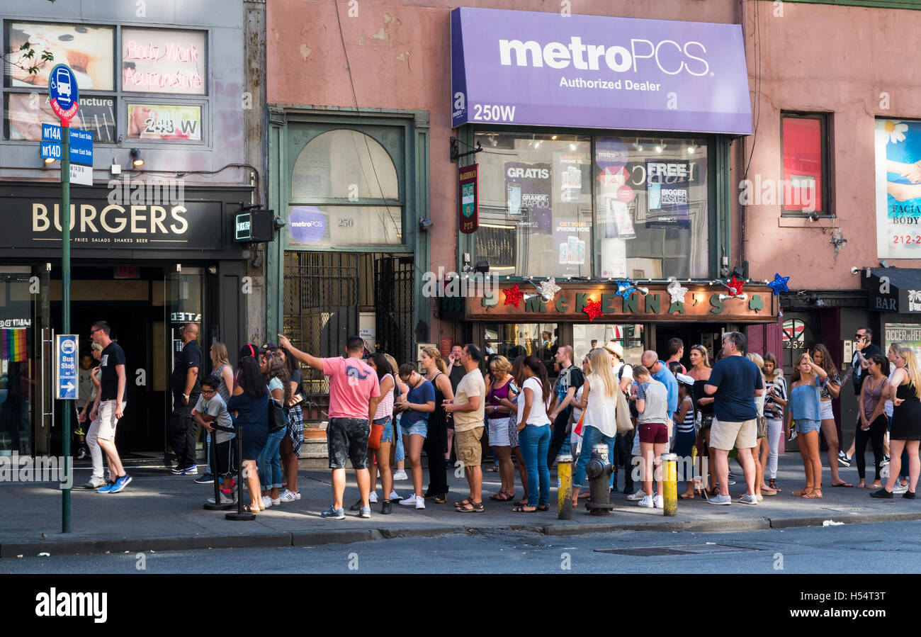 Queue of diners waiting for a table at popular Black Tap burger and milkshake restaurant in Meatpacking District, - Stock Image