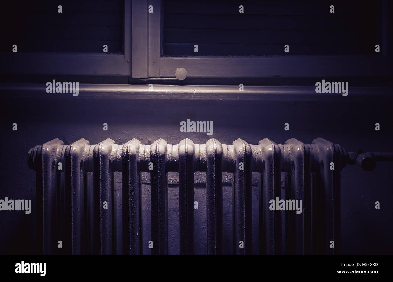Conceptual composition about cold weather, details of an old radiator. - Stock Image