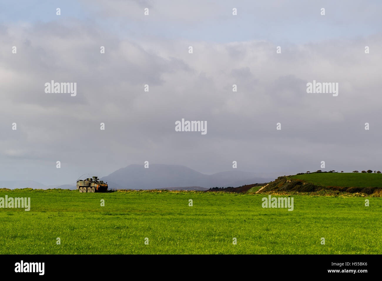Mowag APC of the Irish Army patrols Bantry Airstrip, County Cork, Ireland during an exercise with copy space. - Stock Image