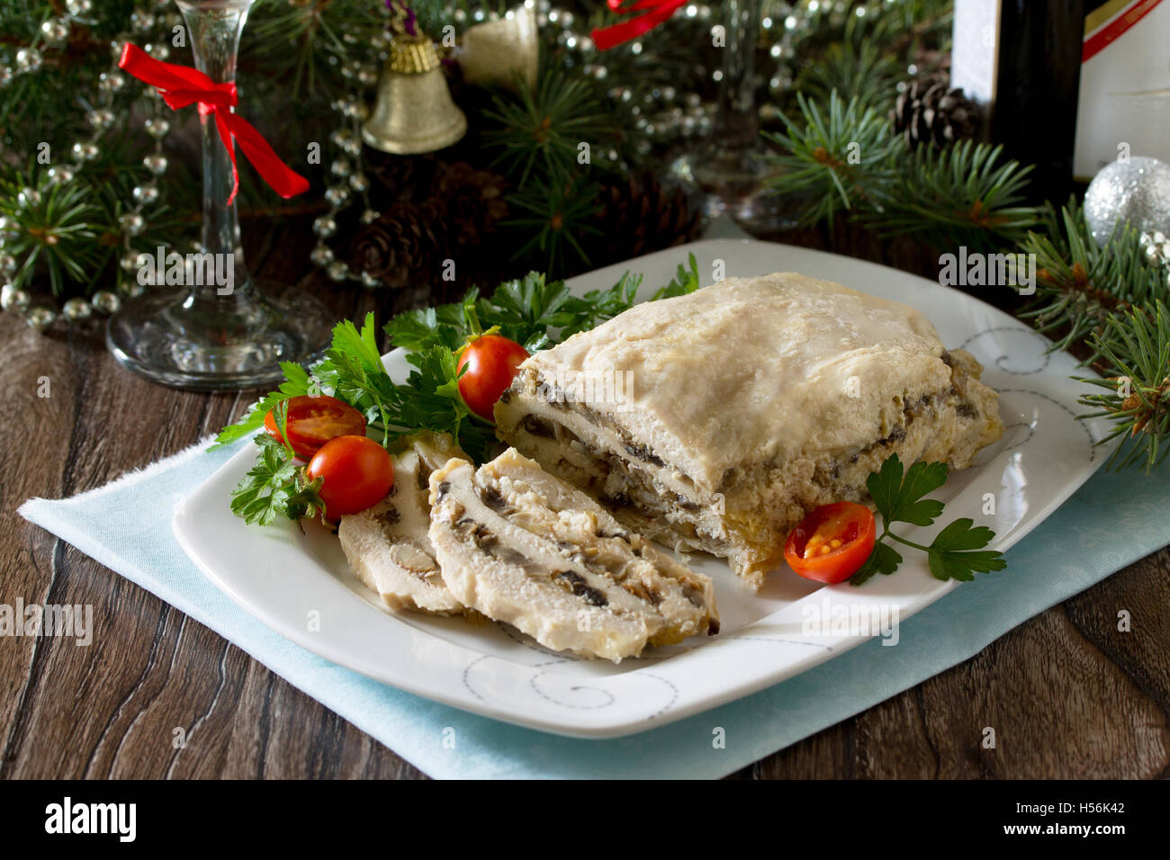 Homemade meatloaf with mushrooms and onions on a festive Christmas table. - Stock Image