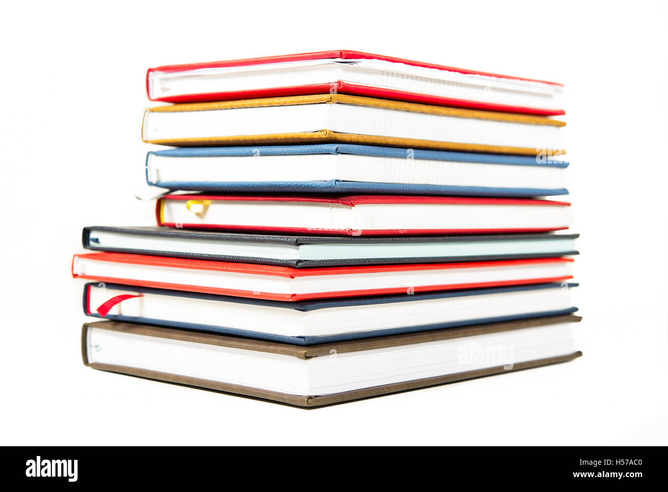 Stack of diaries on white background Stock Photo