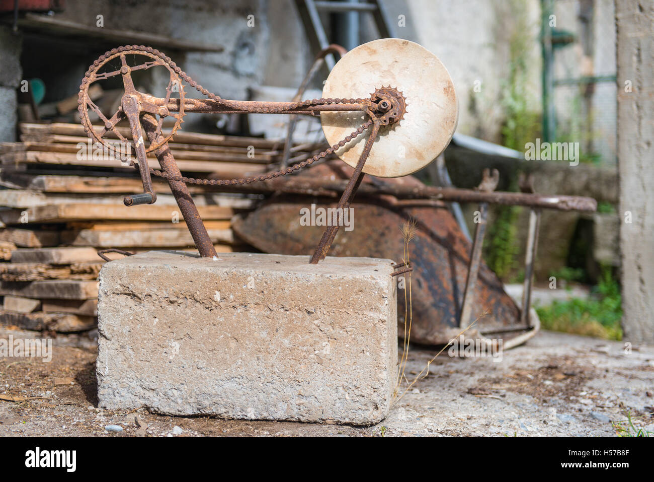 Stone to polish ancient craft rotates in an old junk shop Stock Photo