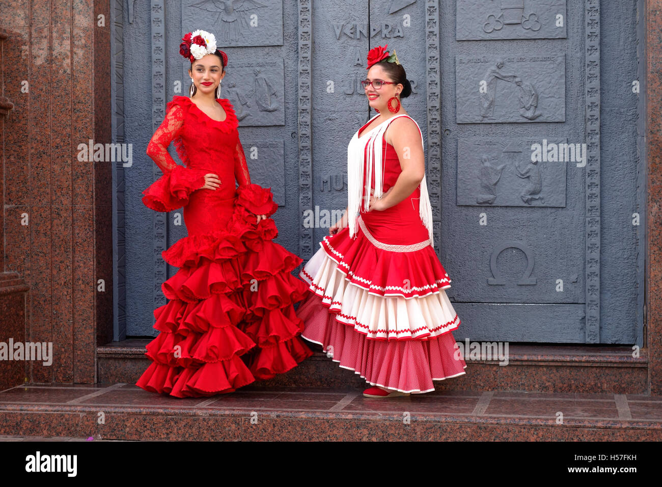 c3d46fd077fd Two girls in a traditional flamenco dresses during the annual feria in  Fuengirola in Southern Spain. Costa del Sol.