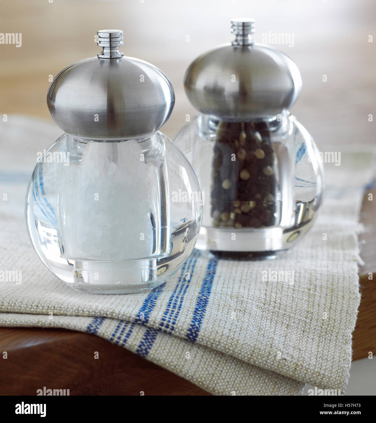 Salt and pepper mills in the kitchen. - Stock Image