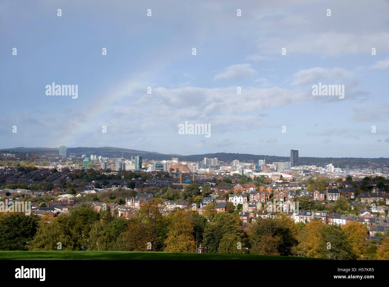 Sheffield, UK 19 Oct 2014: Rainbow over the city strikes Sheffield University Arts Tower on 19 Oct 14 from Meersbrook - Stock Image
