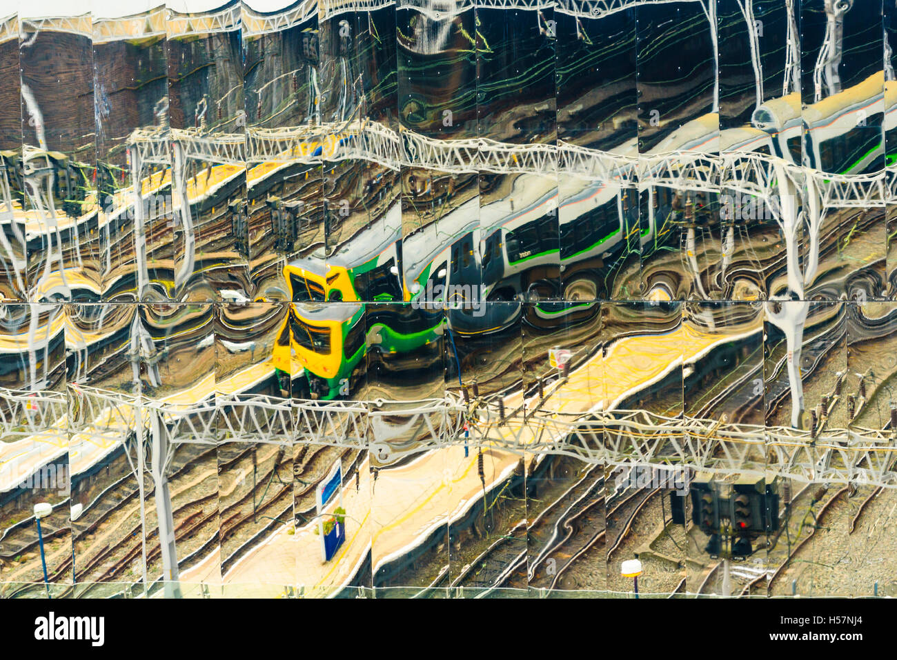 London Midland train reflected in the mirror facade of Birmingham New Street Station - Stock Image