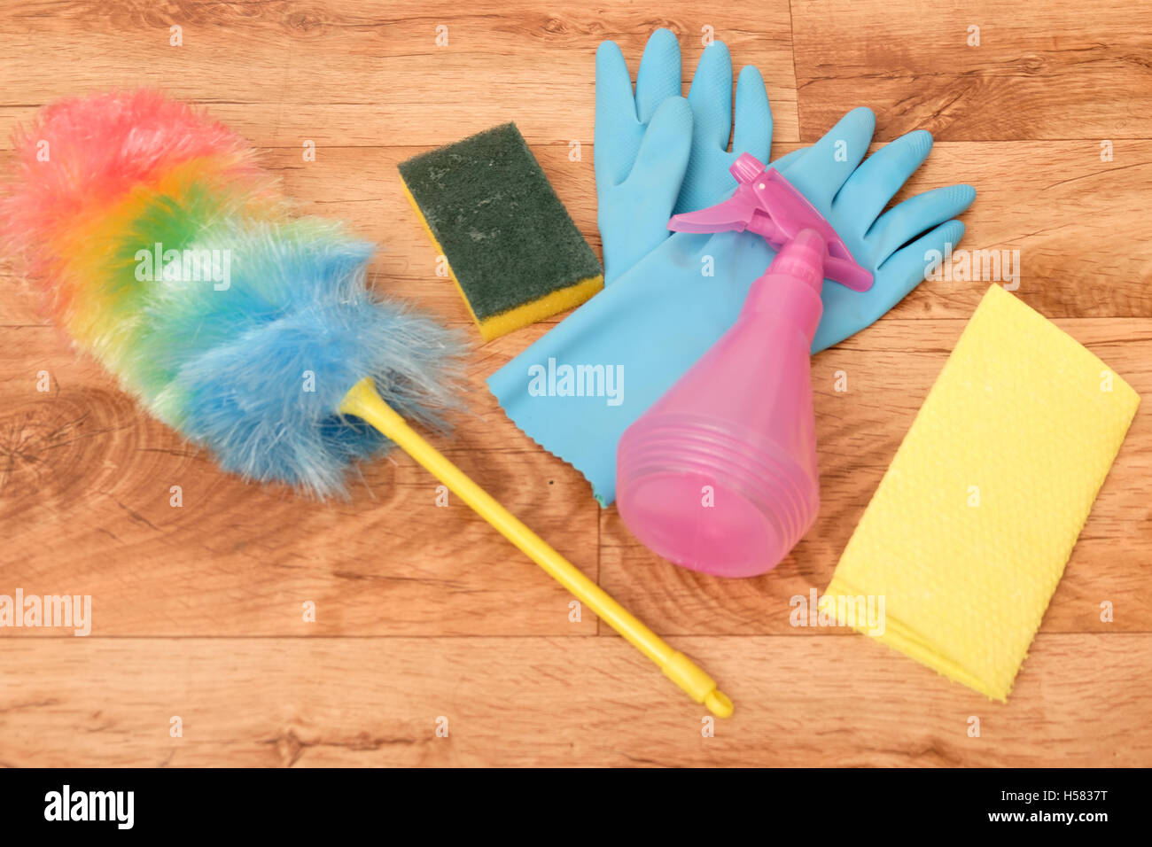 Cleaning tools on a parquet floor - Stock Image