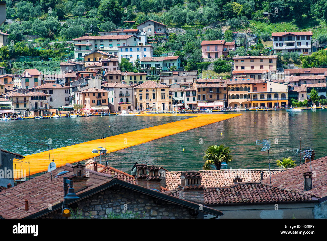 Peschiera Maraglio, Italy - June 17, 2016: The floating piers. The artist Christo walkway on Lake Iseo. The day - Stock Image