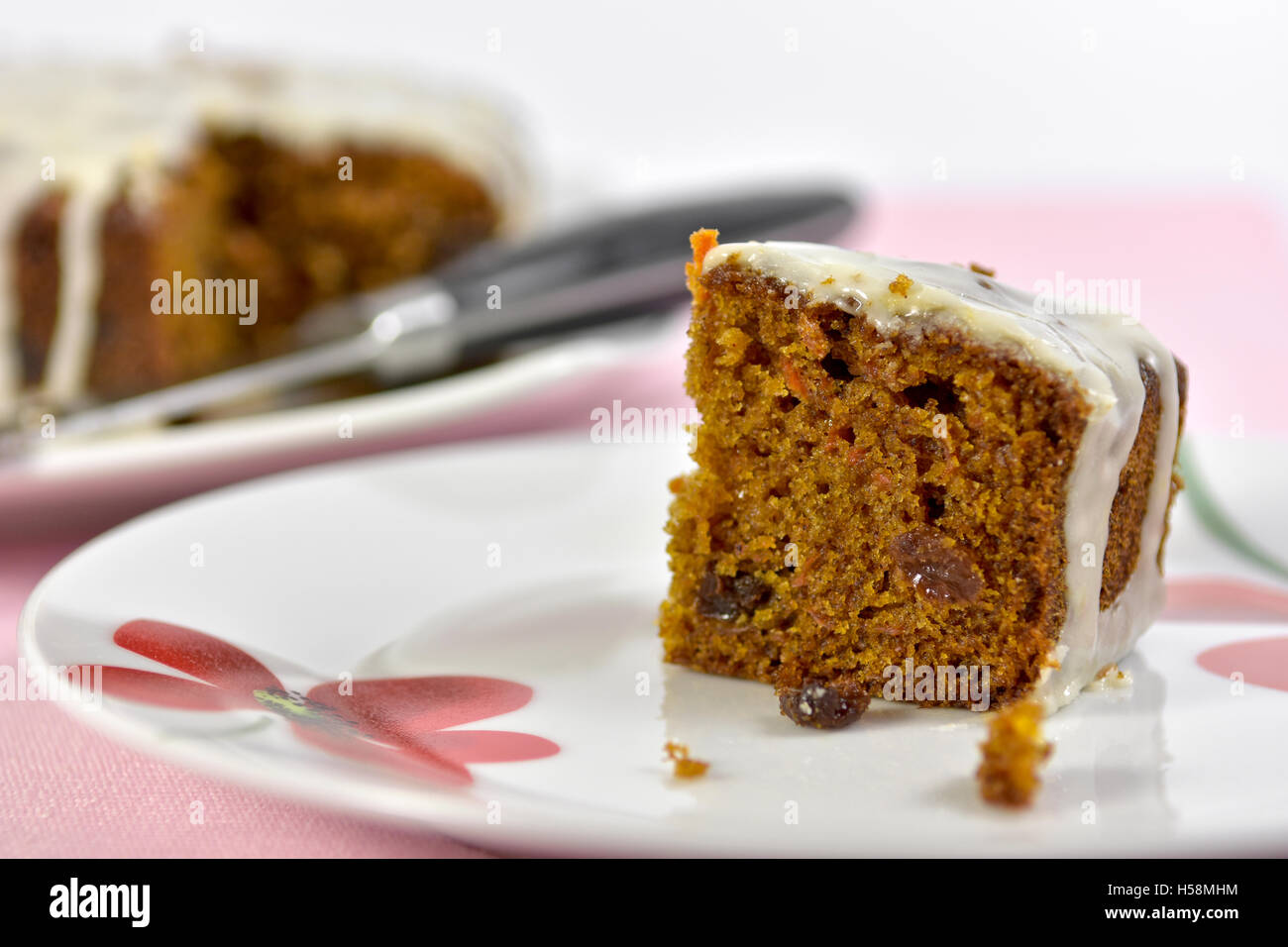 Home made carrot cake slice on plate - Stock Image