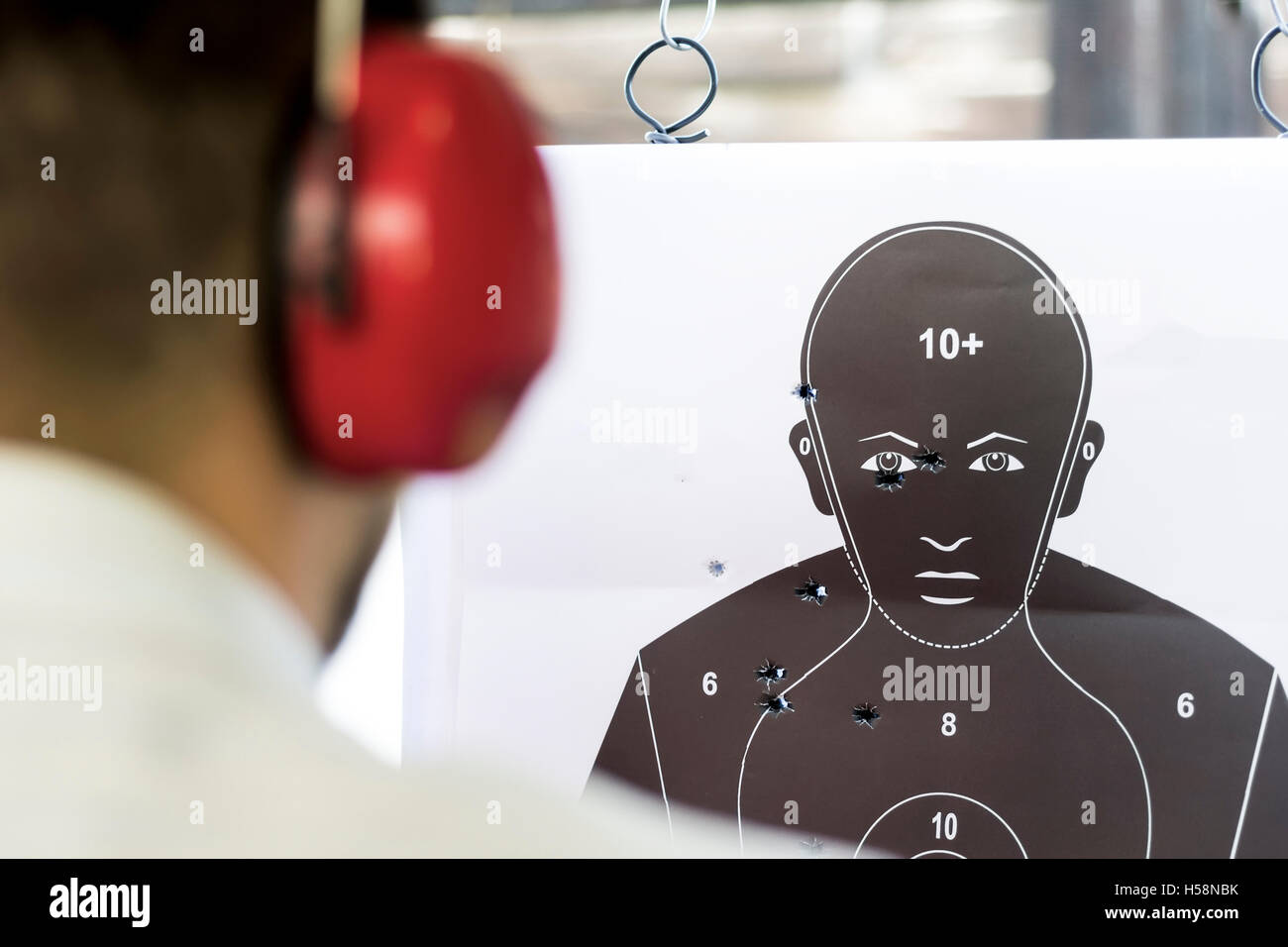 Shooting Target Black Human Silhouette with Holes - Stock Image