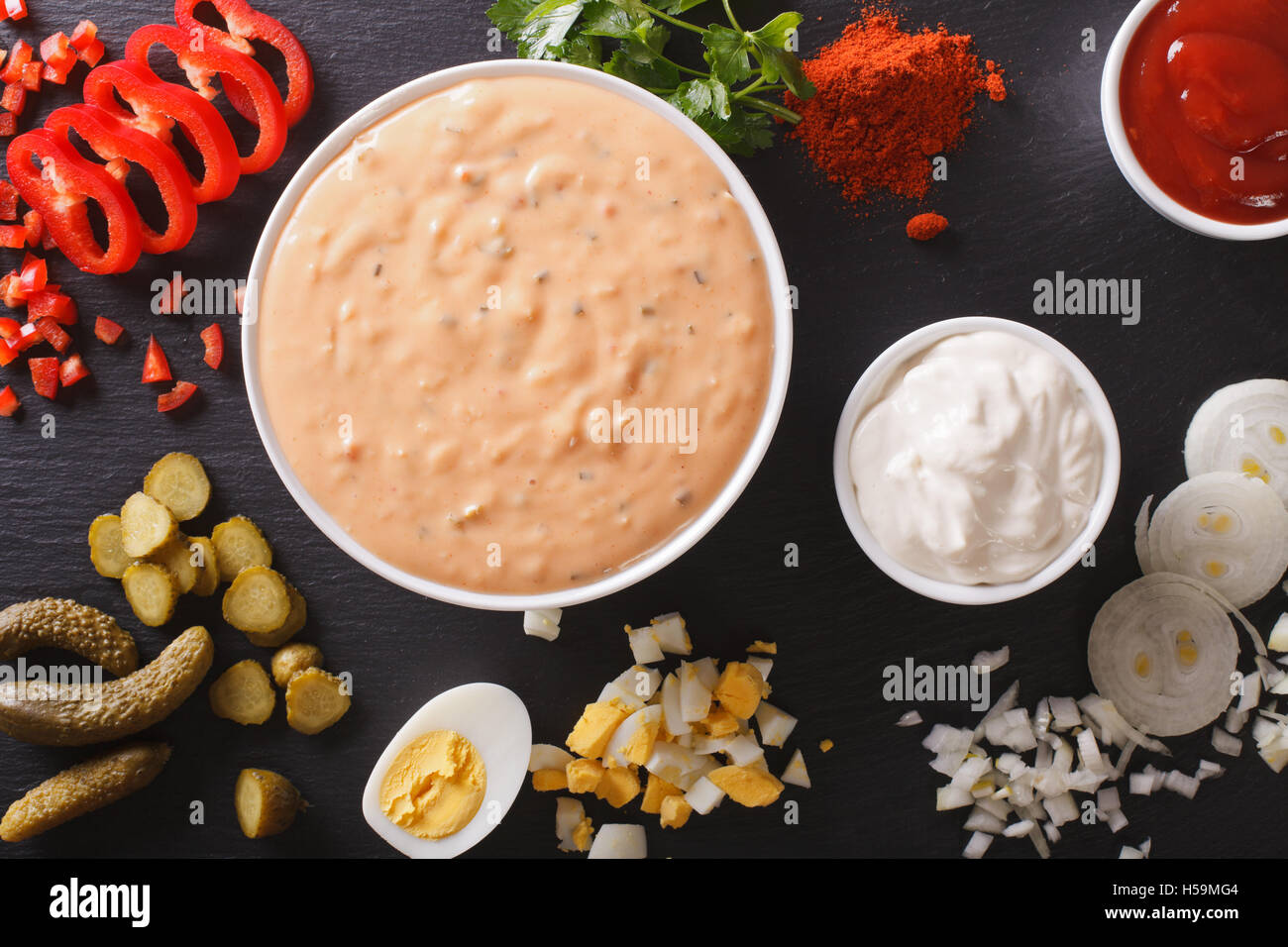 Thousand Island Dressing with ingredients close-up on the table. Horizontal view from above - Stock Image