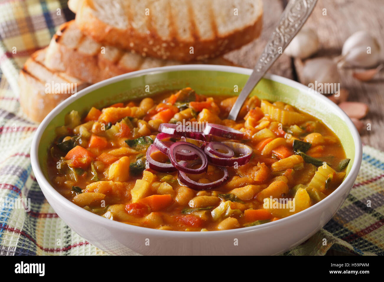 Thick Tuscan soup ribollita close up in a bowl on the table. Horizontal - Stock Image