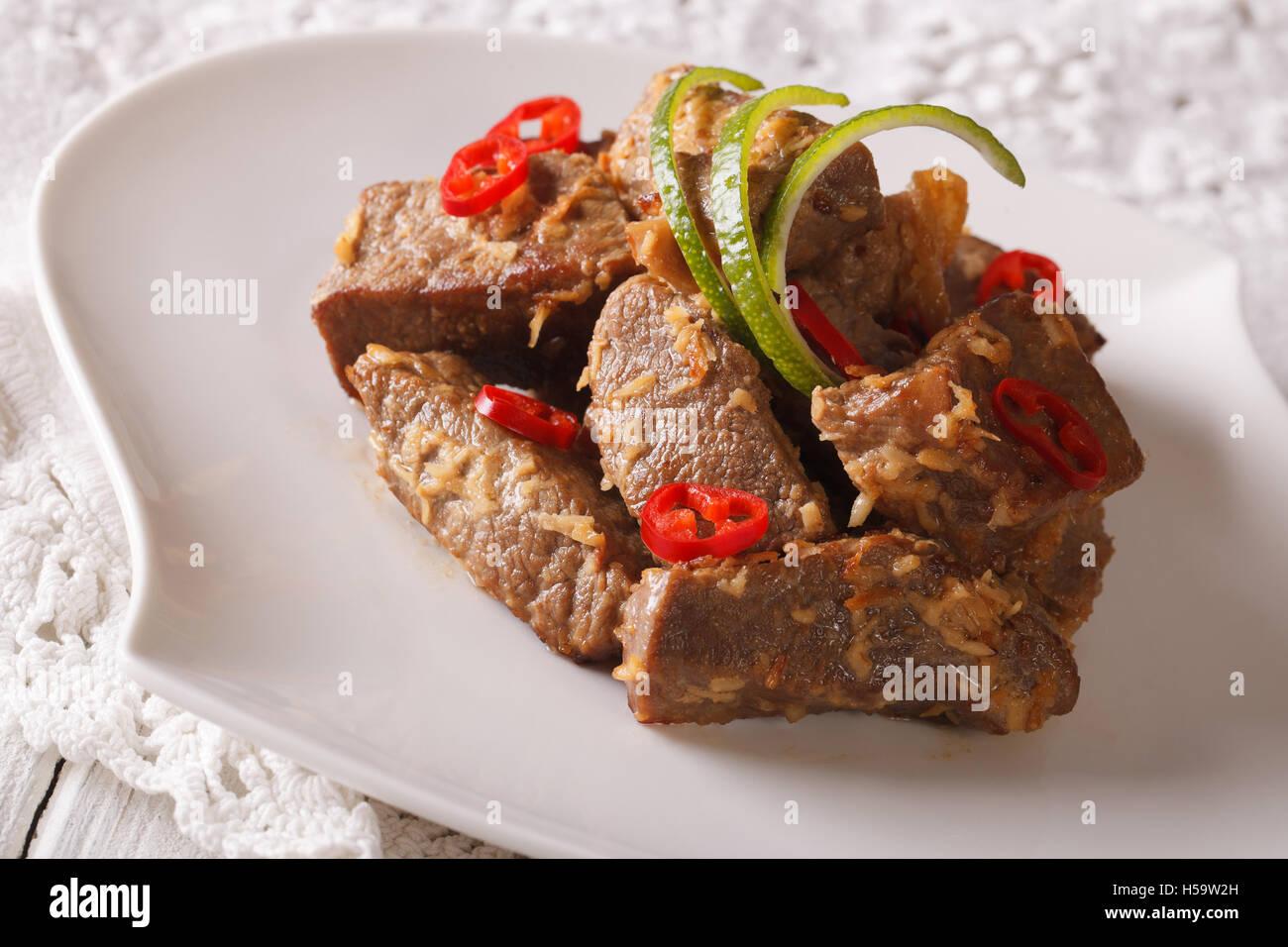 Indonesian cuisine: Beef rendang stewed in coconut milk with