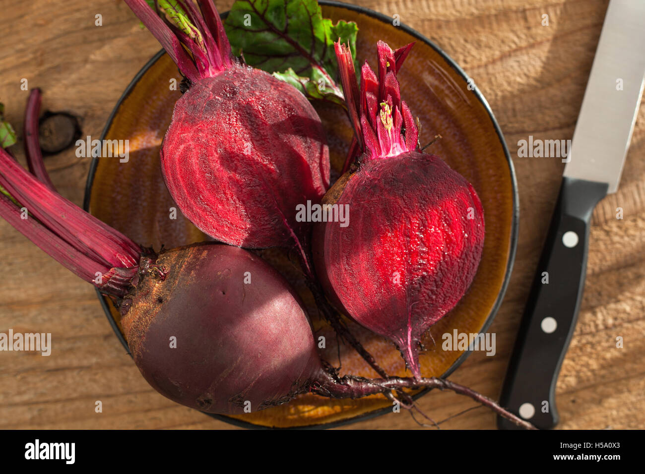 raw beetroot on wooden background - Stock Image
