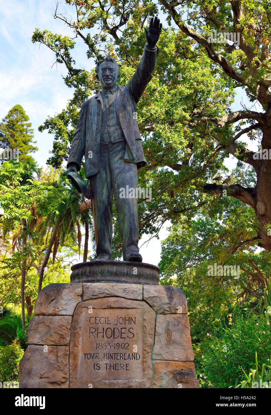 A full statue of Cecil Rhodes African coloniser, wearing a 3-piece suit,standing with his left hand raised and pointing - Stock Image