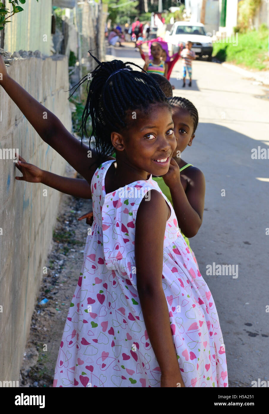 School girls in the'shack settlements' town ship housing in Imizamo Yethu,commonly known as Mandela Park, Cape Town Stock Photo