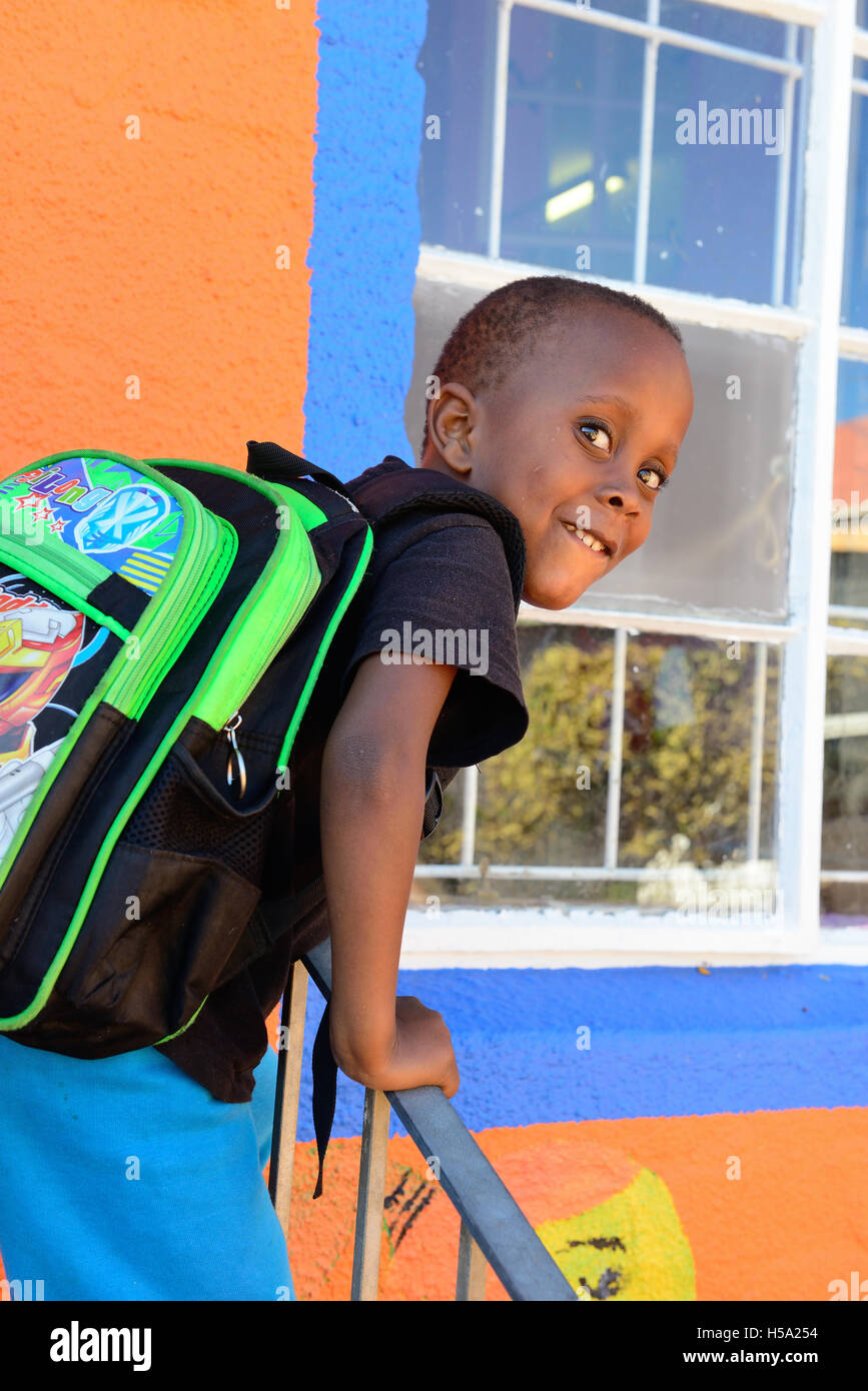 School boy  outside one of Niall Mellon Township Trust  schools in the 'shack settlements' township housing in Imizamo Stock Photo