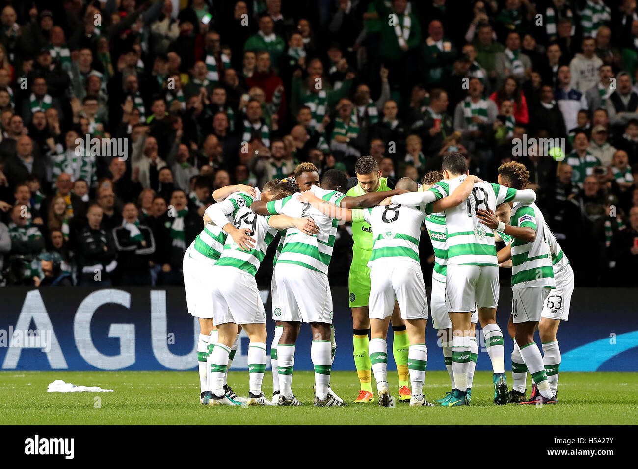 Celtic players form a group huddle before kick off during the UEFA Champions  League match at 4a206bb75