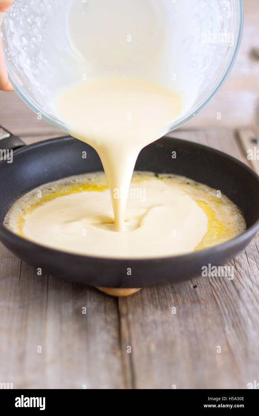 Making German pancakes or Dutch baby pancakes - Stock Image