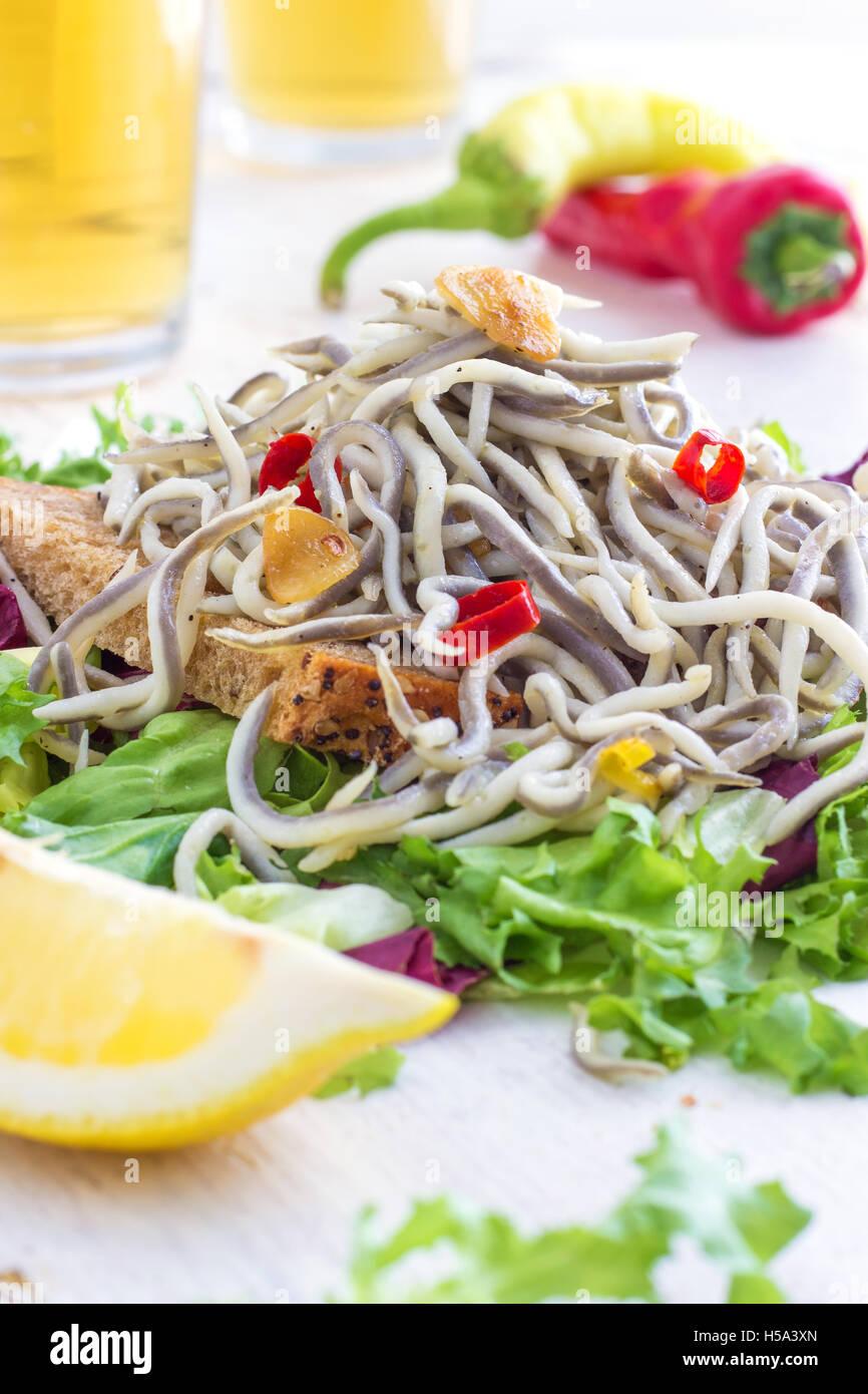 Garlic Angulas (Baby Eels) - Traditional Spanish Tapas - Stock Image