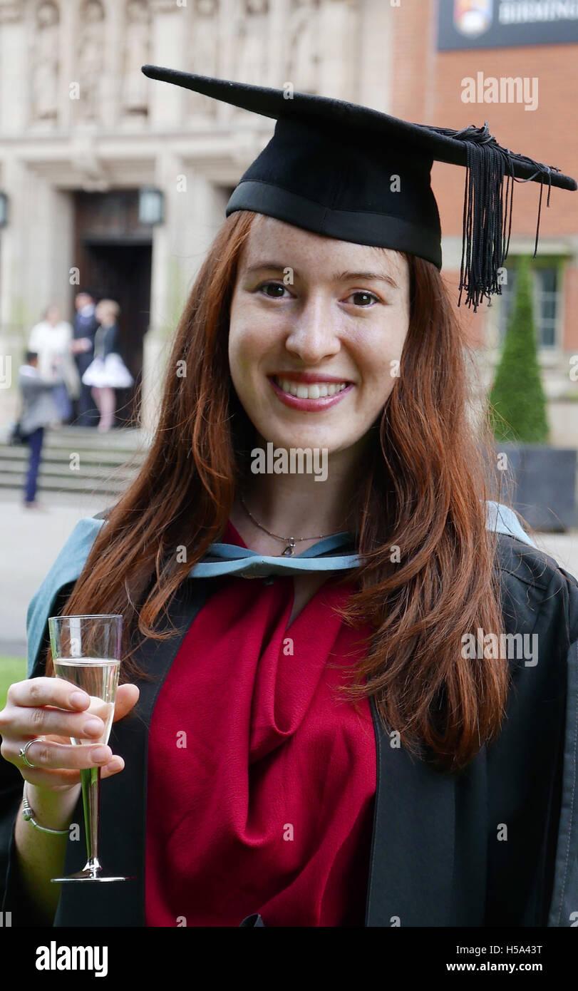 Student  Graduate with Degree celebrating success at Birmingham University - Stock Image
