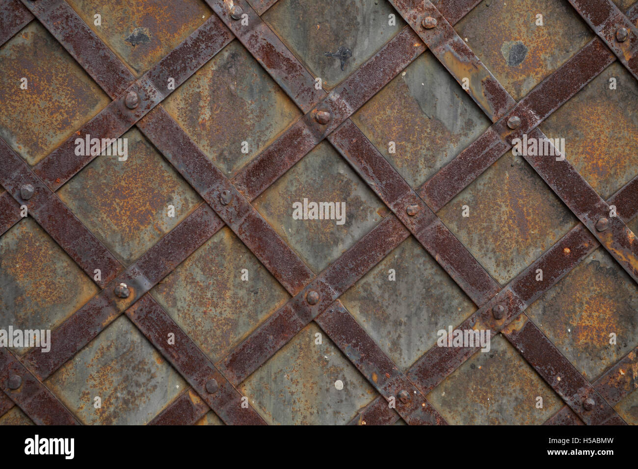 detail of old steel door or grid pattern vintage background - Stock Image