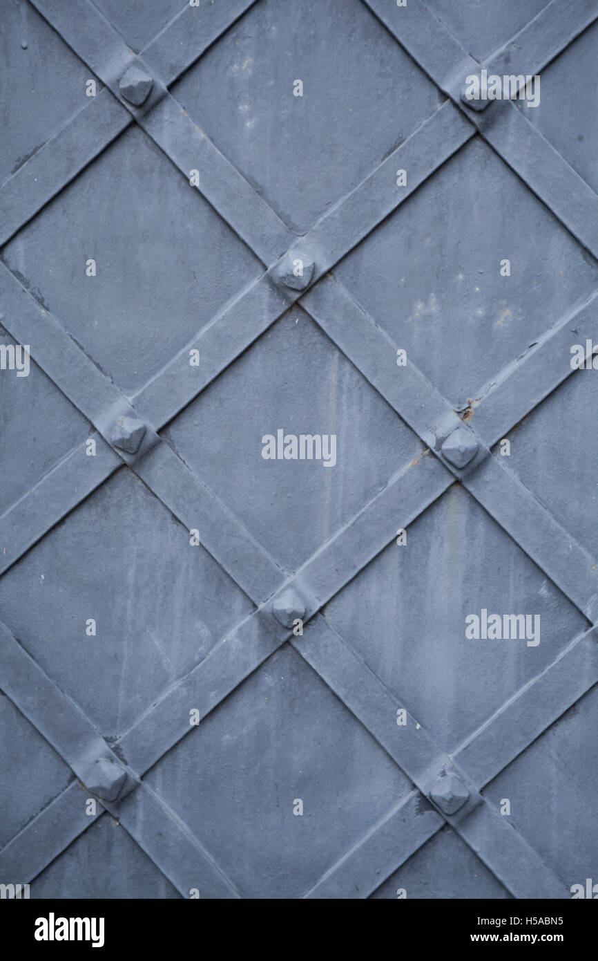 detail of old painted steel door or grid pattern vintage background - Stock Image