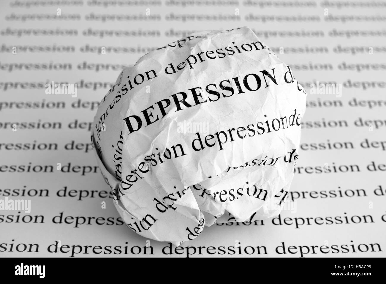Crumpled paper ball with words Depression. Black and white. - Stock Image