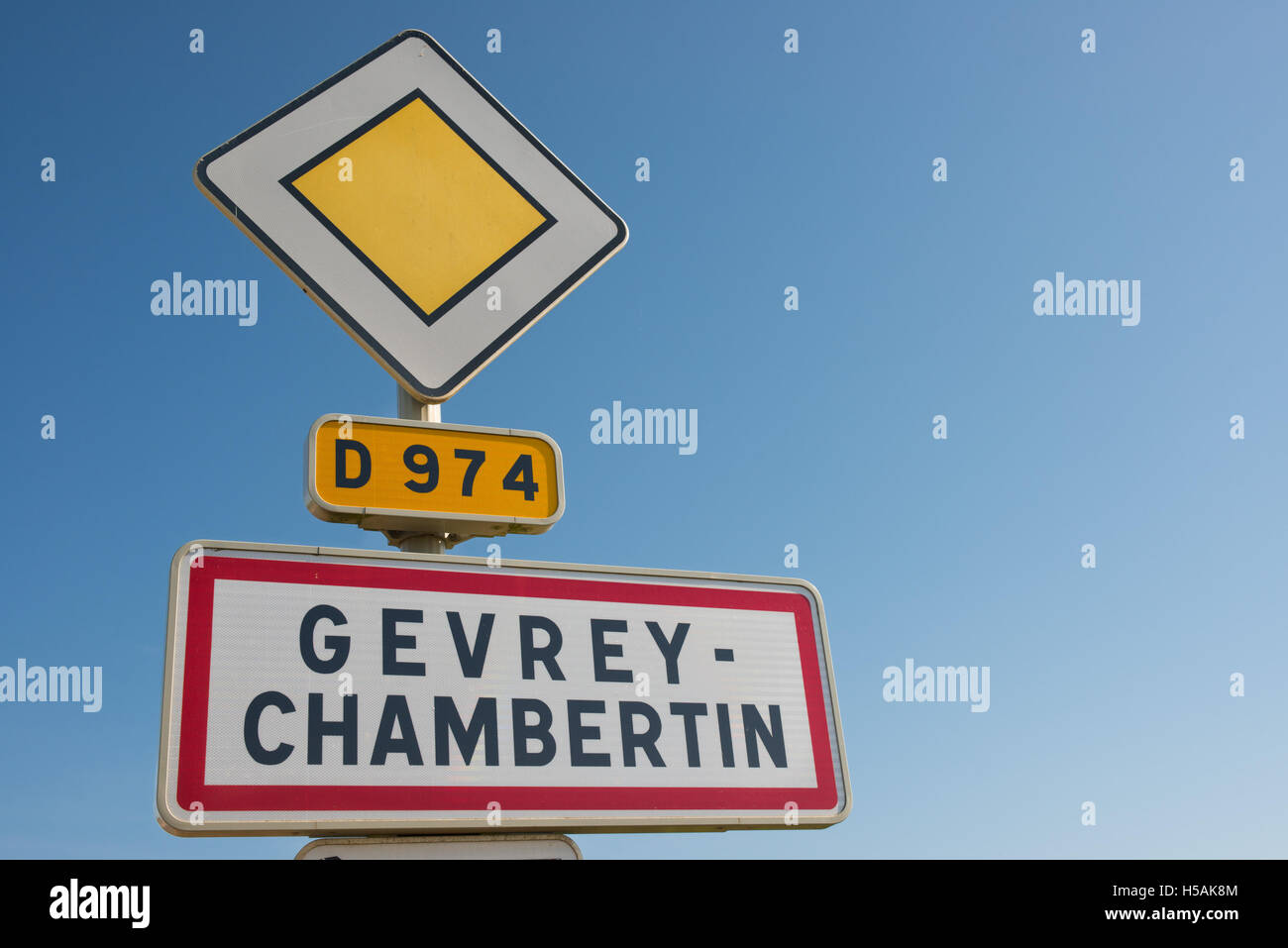 The sign at the village of Gevrey Chambertin denoting the beginning of the conurbation on the route D974, Cote d'Or, - Stock Image
