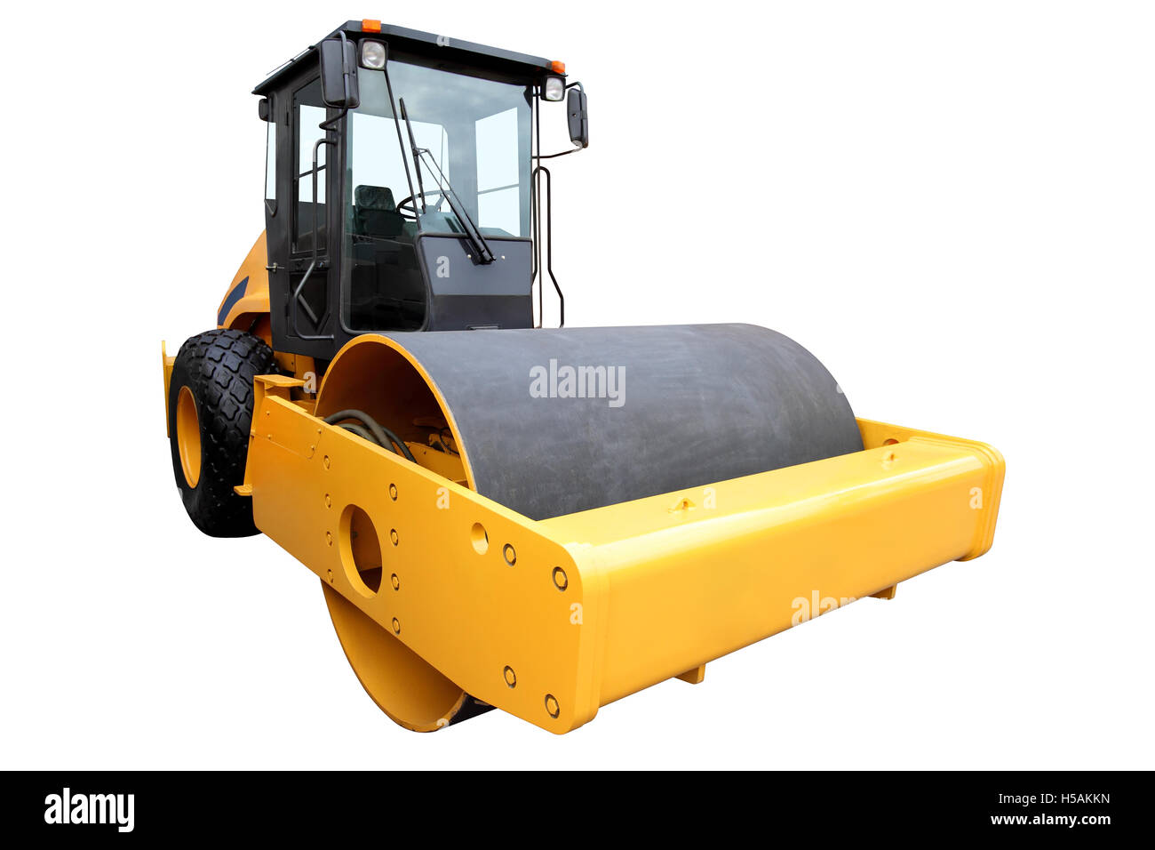 Yellow road-roller for the ground consolidation, isolated on a white background - Stock Image