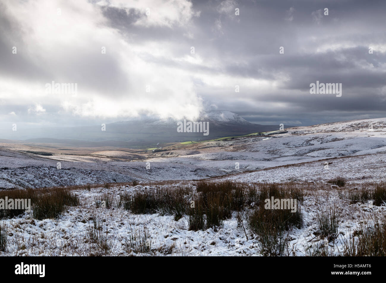 View of snow covered Ingleborough, one of the 3 Peaks in the Yorkshire Dales National Park, England, UK - Stock Image