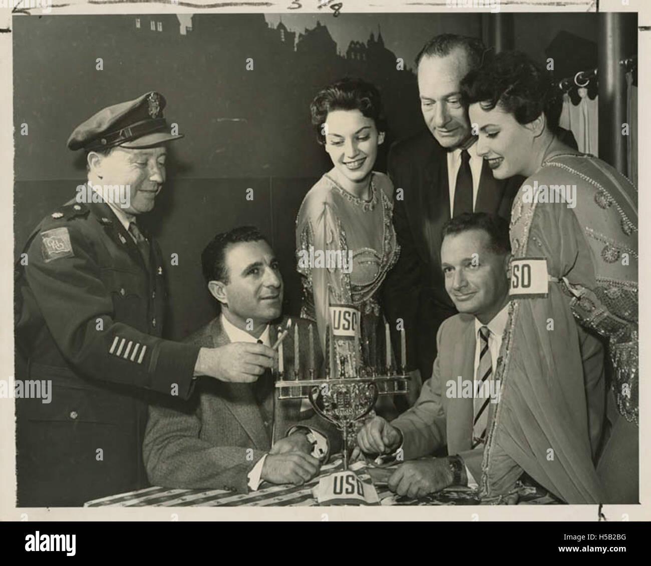 Chaplain Samuel W. Chomsky lights the traditional Hanukkah candles - Stock Image