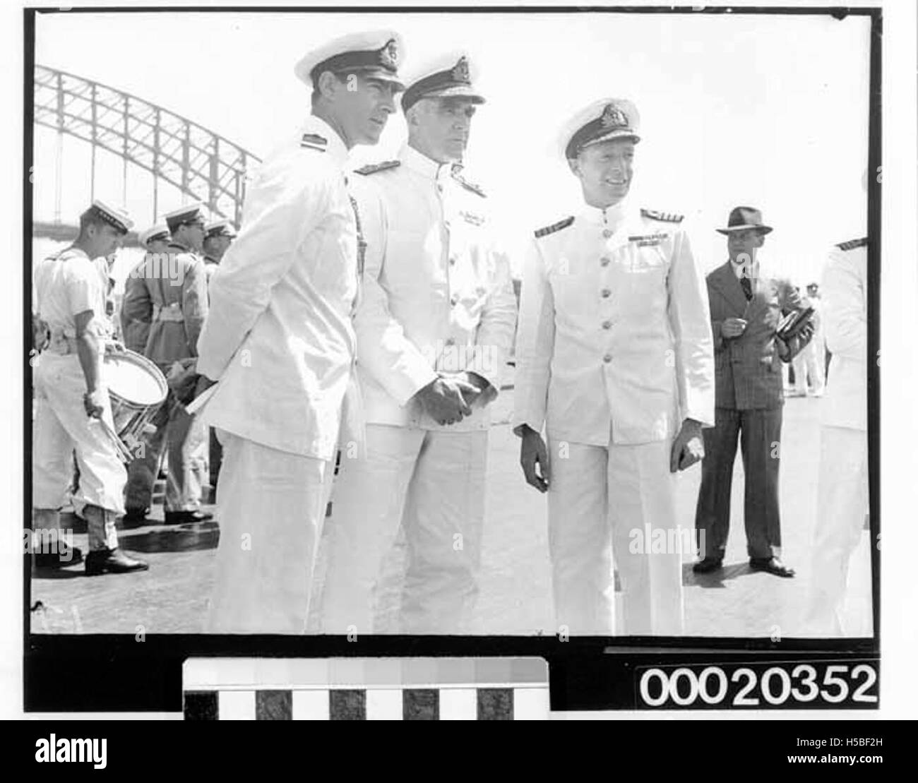 RN Lieutenant Commander Clive Montgomery, RAN Rear⁄Vice Admiral Sir Ragnar Colvin and RAN Captain John Collins at - Stock Image