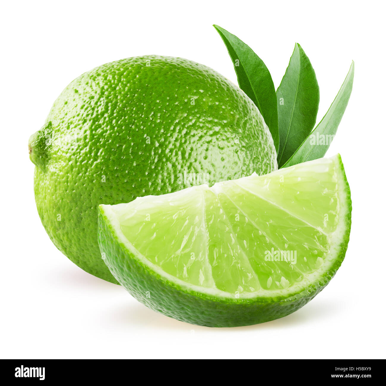 limes isolated on the white background. - Stock Image