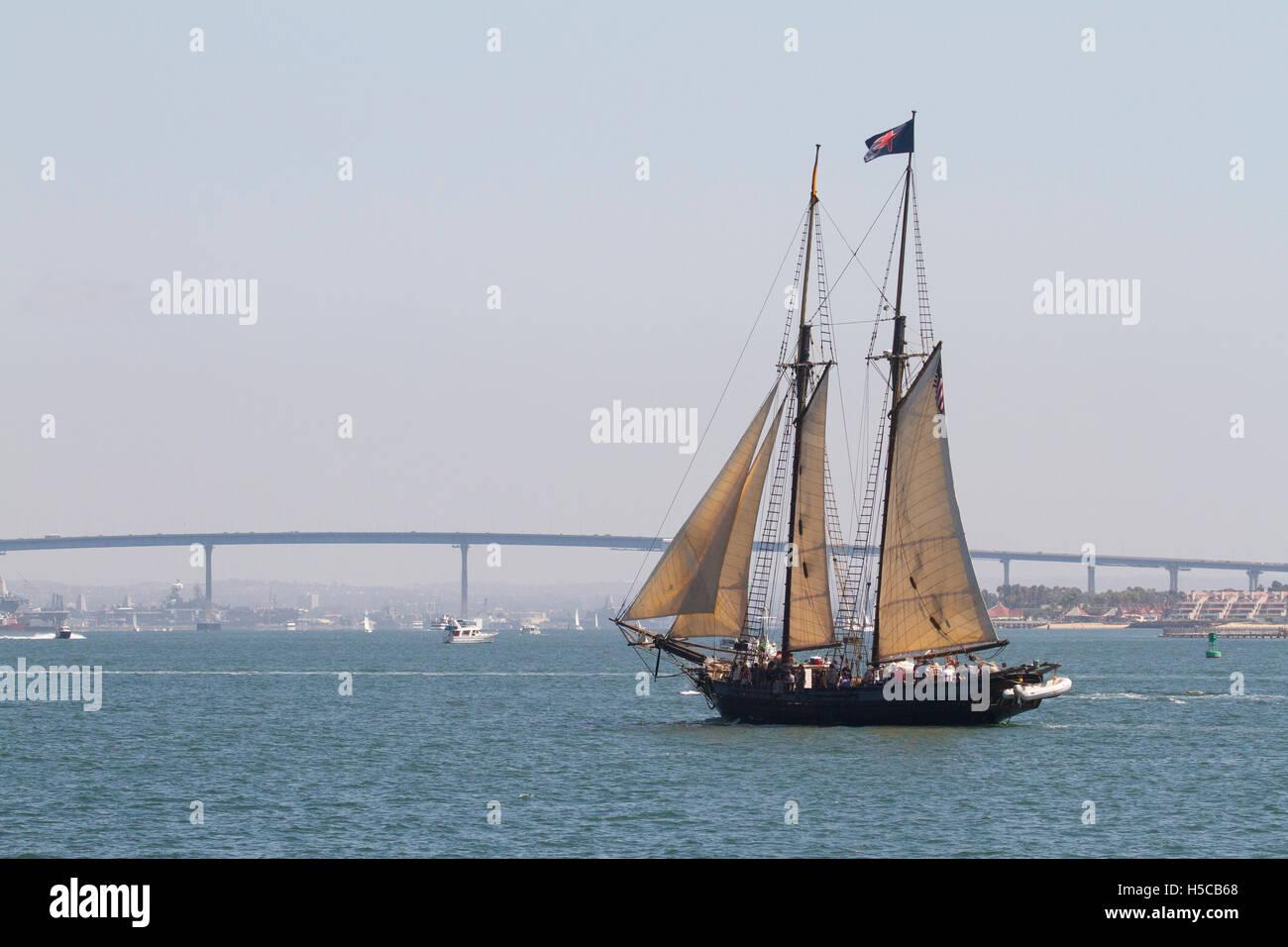 Tall ship Spirit of Dana Point in 2016 Festival of Sail, Parade of Ships, San Diego Bay, CA with Coronado Bridge - Stock Image