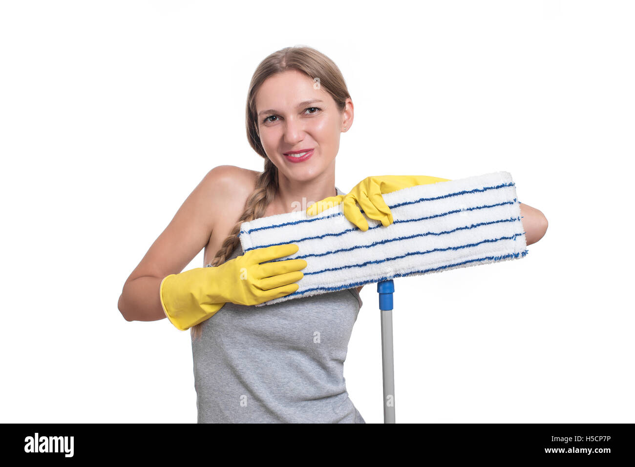Cleaning concept. Woman with floor mop and yellow rubber gloves - Stock Image