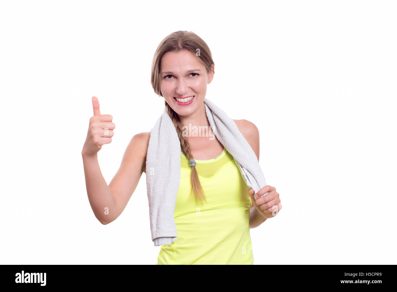 Smiling happy female fitness model looking at camera Stock Photo