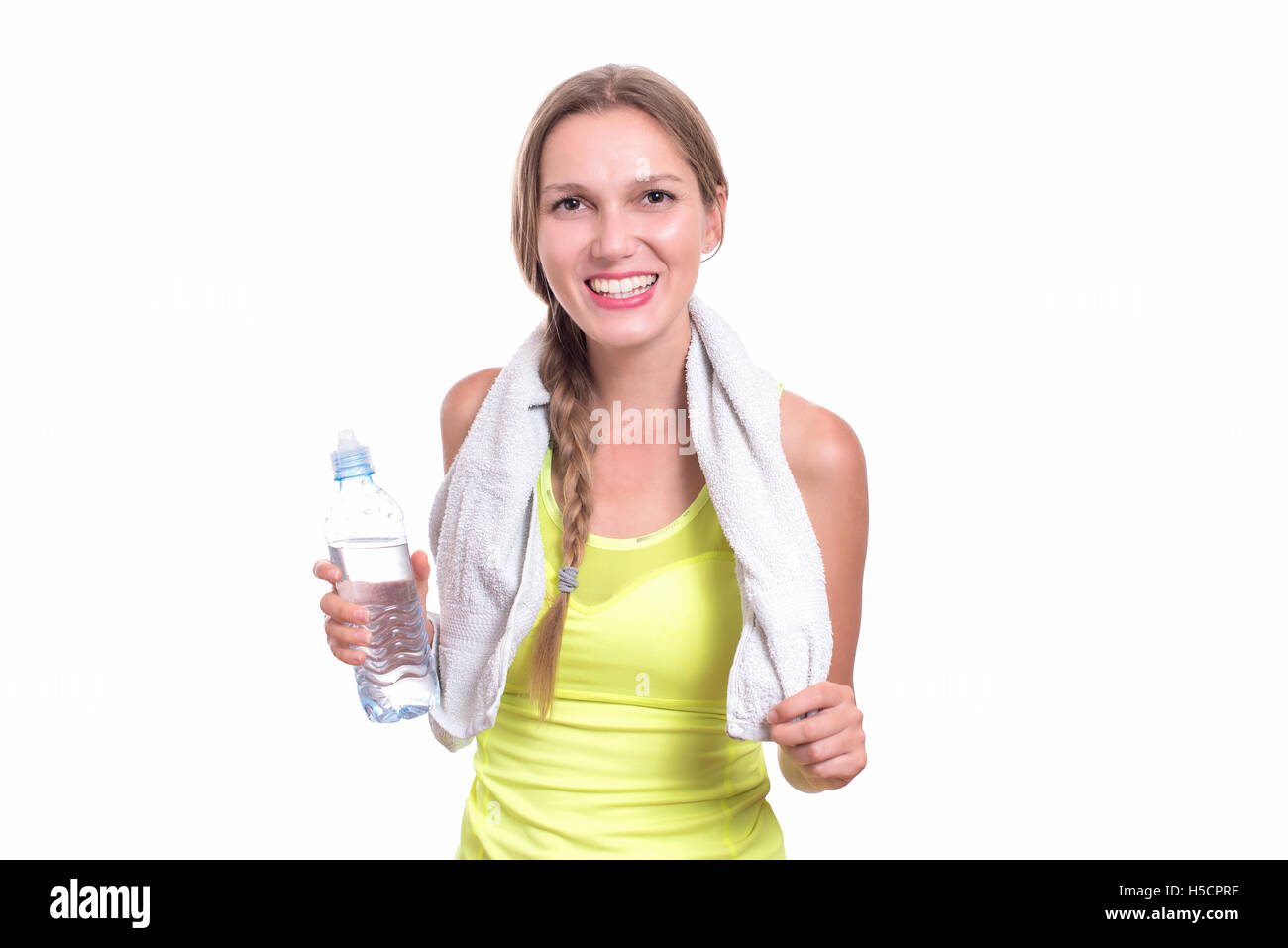 Young gym woman with water bottle smiling isolated on white Stock Photo