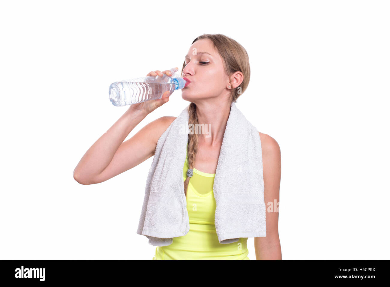 Sporty woman drinking water, isolated on white background Stock Photo