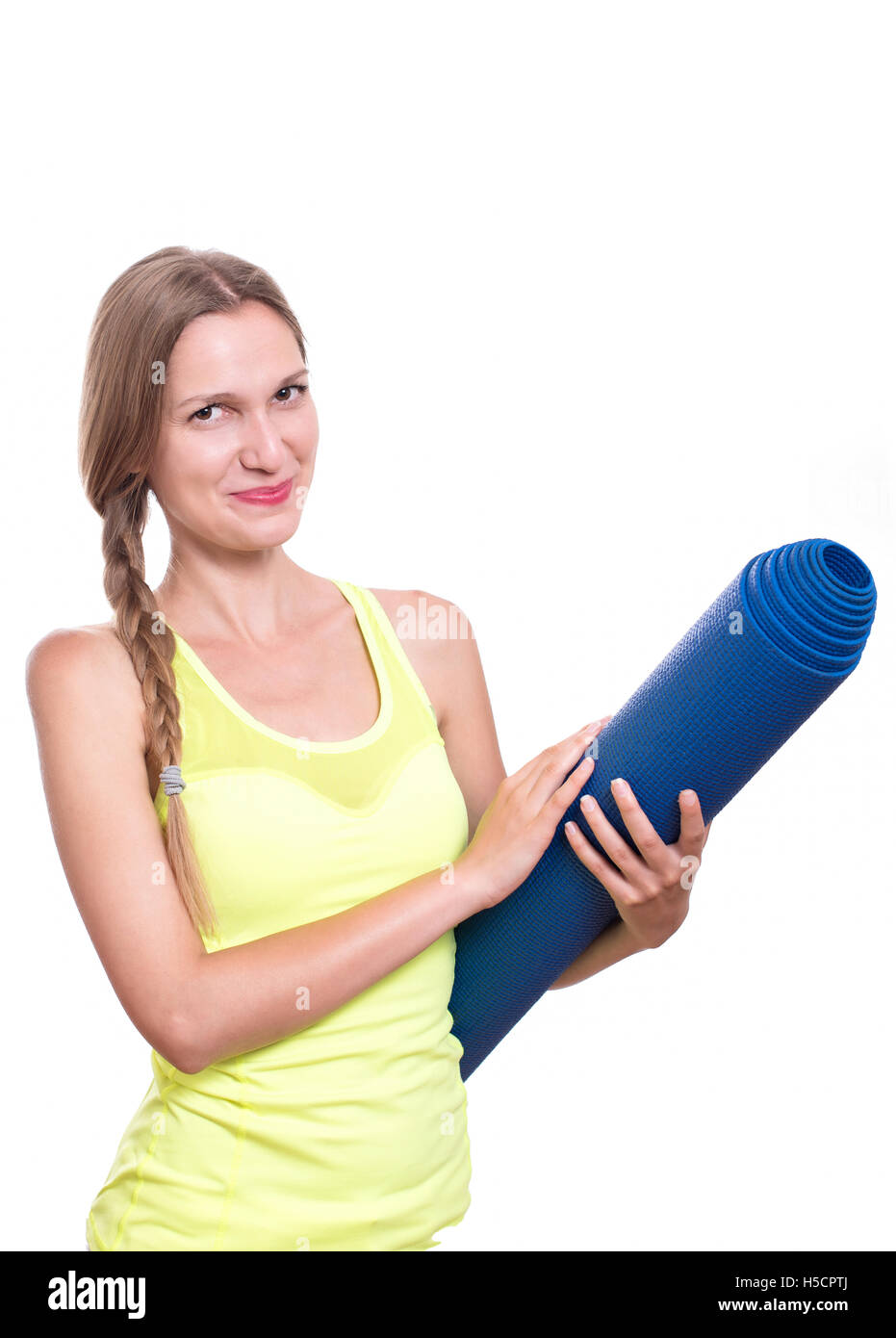 Fitness woman ready for workout, holding yoga mat isolated on white background Stock Photo