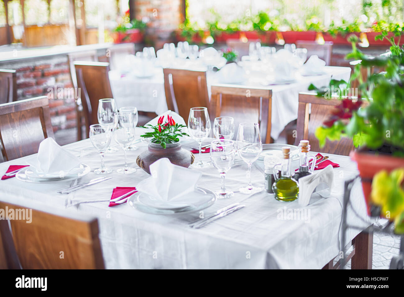 Glasses and plates on table in restaurant Stock Photo