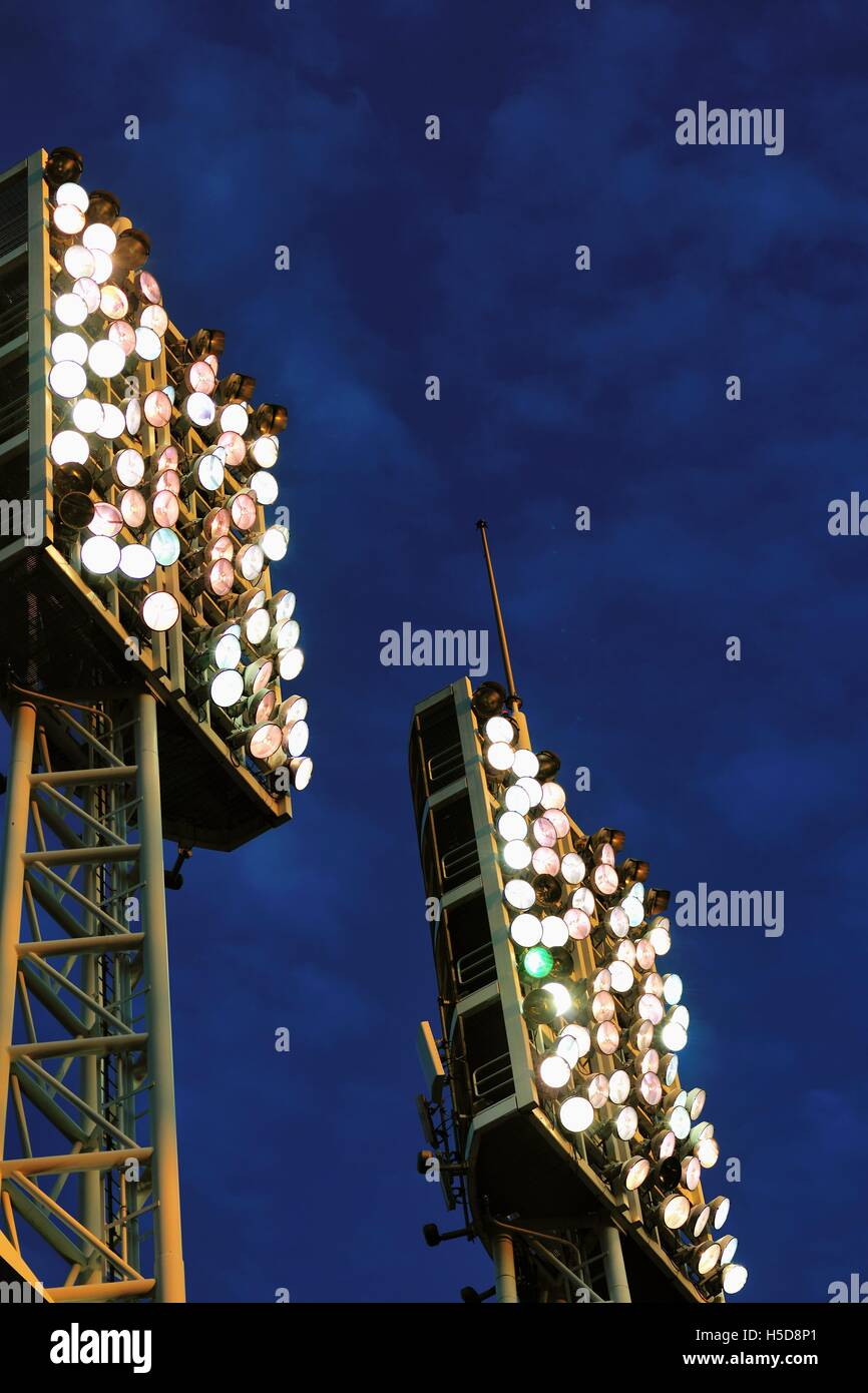 Light towers at the Great American Ballpark, home to the Cincinnati Reds provide illumination for a night game. - Stock Image