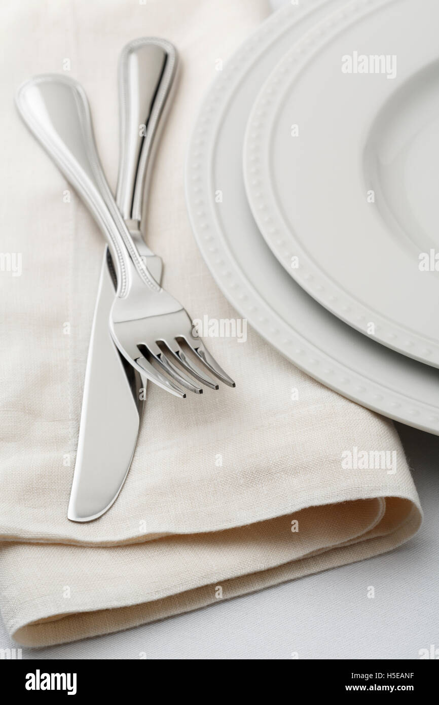 Fine dining classic style table setting place setting with white ...