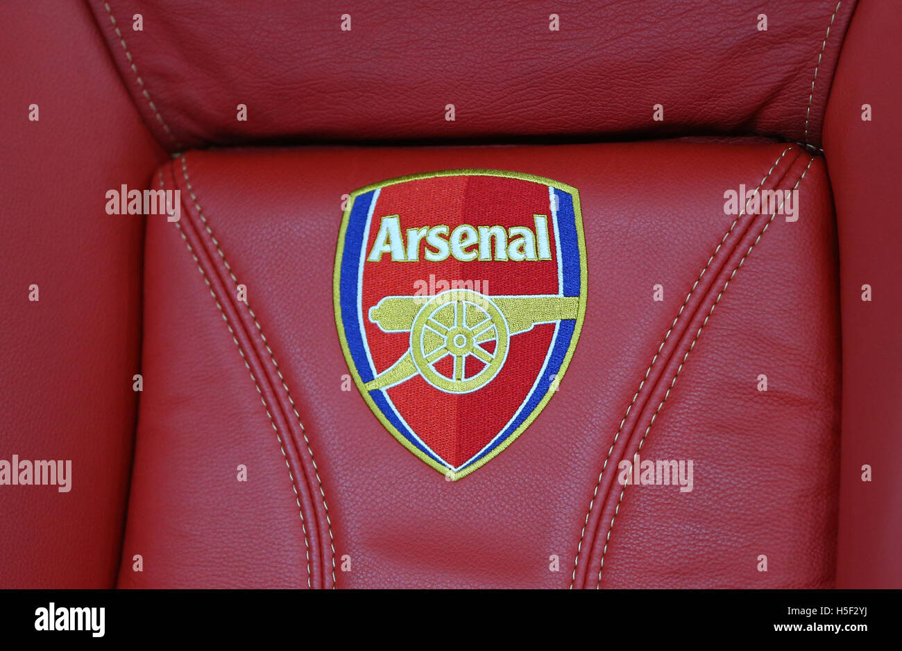 Emirates Stadium, London, UK. 19th Oct, 2016. Arsenal's club badge is seen on a dug-out seat during the UEFA - Stock Image