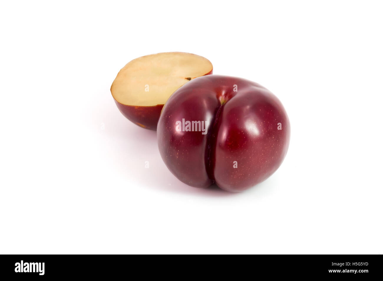Prunes Plum fruit isolated on white - Stock Image