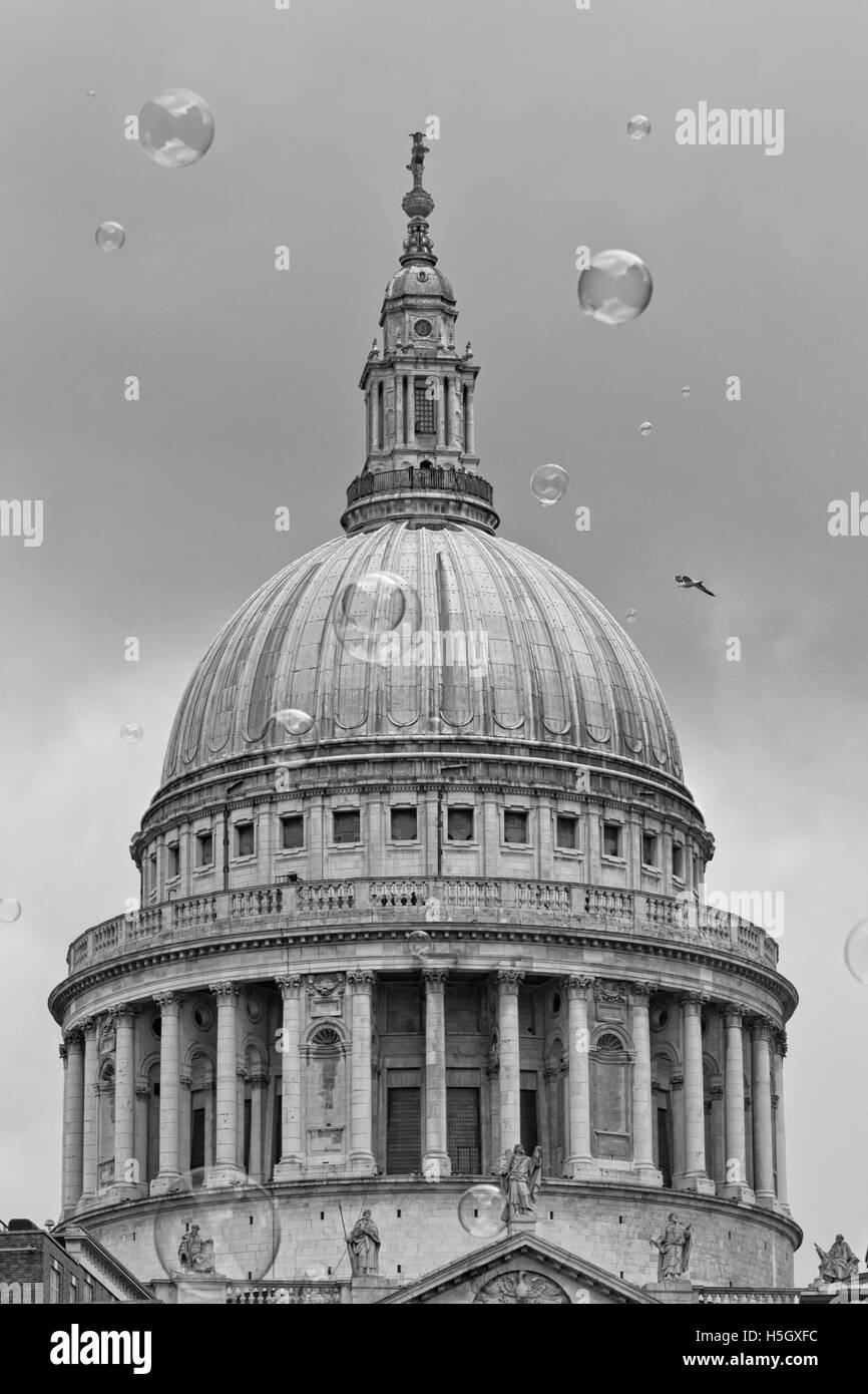 London, UK - July 2016:  Bubbles from a street entertainer, with St Paul's Cathedral in the background, on the - Stock Image